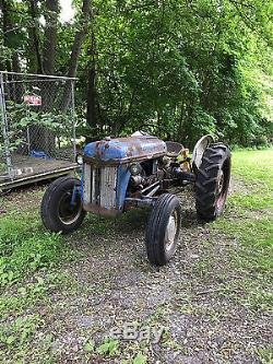 1952 8N Ford Tractor with backup plow attached