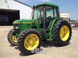 1999 JOHN DEERE 6410 MFWD Tractor