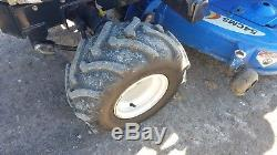 2006 New Holland TZ25DA Compact Tractor with Loader, Belly Mount Lawn Mower Hydro