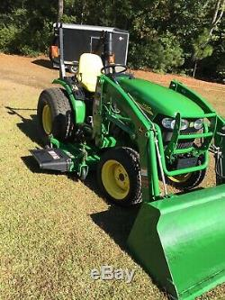2011 John Deere 2520 tractor with 200CX loader and 62D mower deck. 58.5 hours