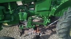 M John Deere Tractor With Cultivators