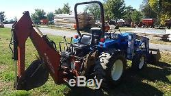 NH TC 30 Compact Loader Tractor WithWoods 7500 Backhoe