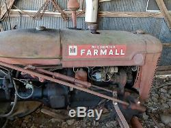 Two vintage Farmall Tractors