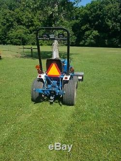 Very Clean Ford New Holland 1220 Tractor withbelly mower front plow CAN SHIP CHEAP